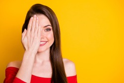 Close-up portrait of her she nice attractive cute cheerful cheery brown-haired girl closing one eye checking eyesight copy space isolated over bright vivid shine vibrant yellow color background