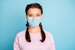 Close-up portrait of her she nice attractive girl wearing safety mask wuhan china viral pneumonia symptom syndrome contamination prevention isolated bright vivid shine vibrant blue color background