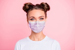 Close-up portrait of her she nice attractive lovable cute adorable winsome girl with two buns wear white shirt protection flu cold facial mask isolated over pink pastel background