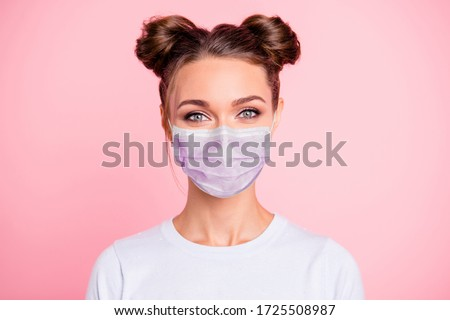 Photo of  Close-up portrait of her she nice attractive lovable cute adorable winsome girl with two buns wear white shirt protection flu cold facial mask isolated over pink pastel background