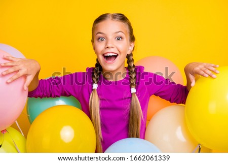 Close-up portrait of her she nice attractive lovely charming excited cheerful cheery girl among bunch balls isolated over bright vivid shine vibrant yellow color background Сток-фото ©