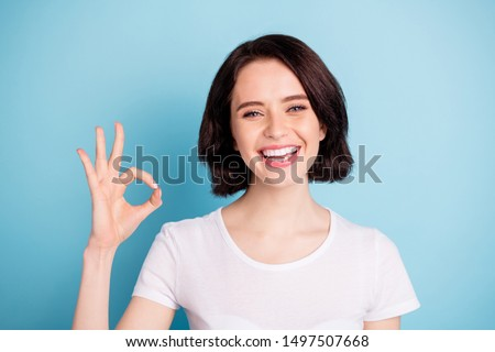 Close-up portrait of her she nice attractive lovely cheerful cheery girl showing ok-sign ad solution good choice isolated on bright vivid shine vibrant blue turquoise color background