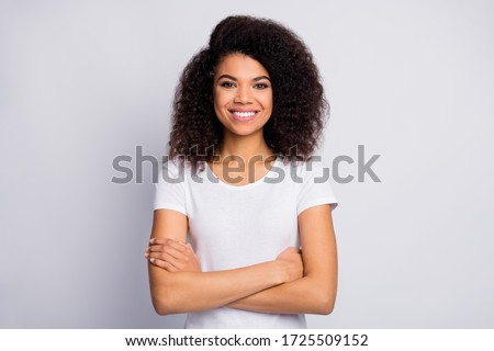 Close-up portrait of her she nice attractive lovely pretty cheerful cheery glad wavy-haired girl folded arms isolated over light white pastel color background