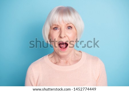 Close-up portrait of her she nice attractive lovely well-groomed stunned healthy gray-haired lady opened mouth expression isolated over bright vivid shine blue green teal background