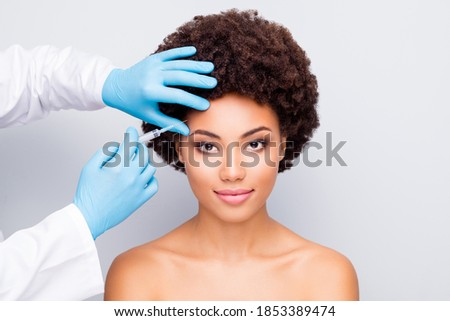 Close-up portrait of her she nice attractive peaceful perfect wavy-haired girl doctor's hand doing prick natural organic filler anti wrinkles detox isolated on light white gray color pastel background