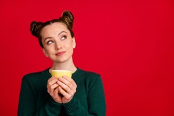 Close-up portrait of her she nice attractive pretty cute creative dreamy cheery girl drinking cacao latte fantasizing copy space isolated on bright vivid shine vibrant red color background