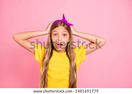 Close-up portrait of her she nice attractive pretty frightened pre-teen girl wearing yellow t-shirt stunning expression isolated over pink pastel background