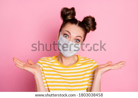 Close-up portrait of her she nice attractive puzzled confused indifferent girl wearing safety mask shrugging shoulders mers cov pandemia disease risk isolated pastel pink color background
