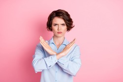 Close-up portrait of her she nice attractive sullen grumpy brown-haired girl showing crossed hands enough decision isolated over pink pastel color background