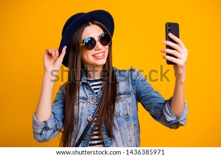 Close-up portrait of her she nice-looking charming attractive lovely winsome fascinating cheerful cheery straight-haired lady making taking selfie isolated over bright vivid shine yellow background