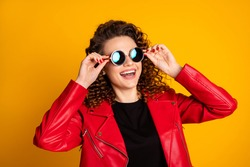 Close-up portrait of her she nice lovely cheerful wavy-haired girl touching round sun specs isolated on bright yellow color background