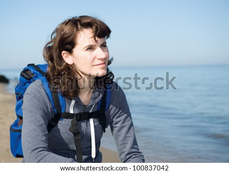 Close-up portrait of hiking woman relaxing at sea