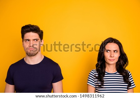 Close-up portrait of his he her she nice attractive offended angry mad dissatisfied people thinking of divorce life crisis scolding isolated over bright vivid shine yellow background