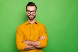 Close-up portrait of his he nice attractive cheerful cheery bearded guy in casual formal shirt office employee folded arms isolated on bright vivid shine vibrant green color background