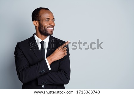 Close-up portrait of his he nice attractive cheerful cheery classy guy employee banker economist ceo boss chief showing decision ad advert advice copy space isolated over grey pastel color background