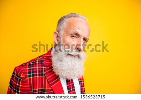 Close-up portrait of his he nice attractive serious suspicious gray-haired man wearing checked jacket looking at camera you isolated over bright vivid shine vibrant yellow color background ストックフォト ©