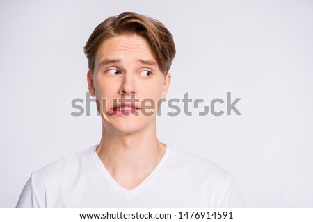 Close-up portrait of his he nice cute attractive worried uncertain guy looking aside oops mistake fail isolated over light white pastel background