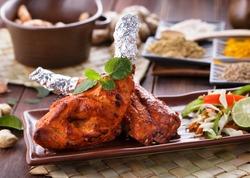 close up portrait of indian tandoori chicken garnished