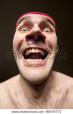 Close-up portrait of insane funny surprised man