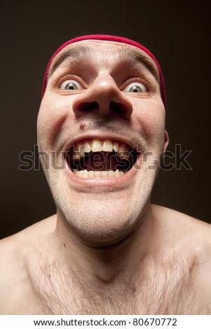 Close-up portrait of insane funny surprised man