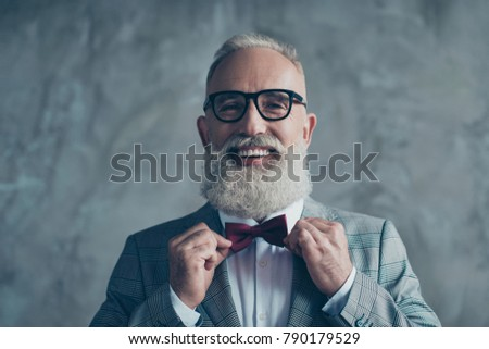 Close up portrait of joyful excited with toothy beaming smile stylish trendy grey-haired groomed sharp dressed elegant smart handsome attractive entrepreneur choose bow-tie isolated on gray background