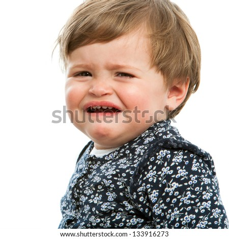 Close up portrait of little girl crying. Isolated on white.