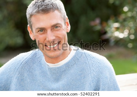 Close Up Portrait Of Man Standing Outside In Autumn Landscape