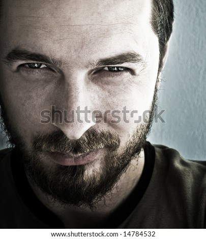 Close-up portrait of man with deep sparkling eyes