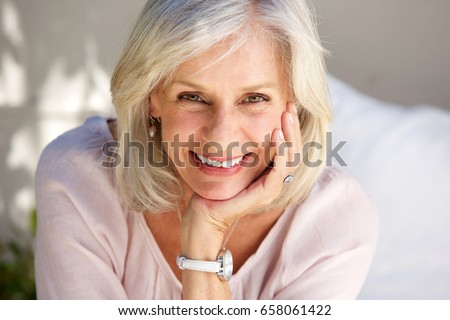 Close up portrait of mature woman smiling outside #658061422