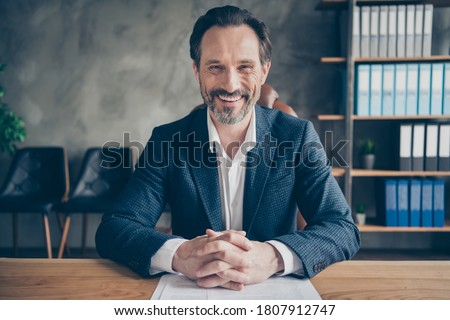 Close-up portrait of  nice attractive cheerful cheery glad man specialist economy expert meeting hiring staff company growth entrepreneurship at modern concrete industrial work place station