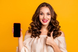 Close-up portrait of nice attractive lovely cheerful cheery wavy-haired lady using new cool 5g app internet online showing thumbup advice ad isolated over bright vivid shine yellow background
