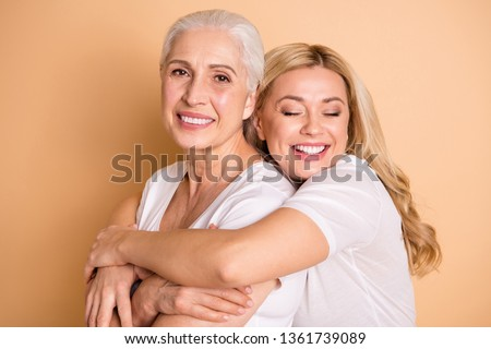Close-up portrait of nice-looking attractive cute charming sweet tender gentle lovely cheerful ladies supporting granny mom mommy mum isolated over beige pastel background #1361739089