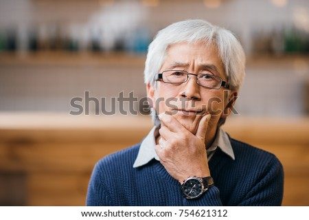 close-up portrait of of thoughtful senior asian man #754621312