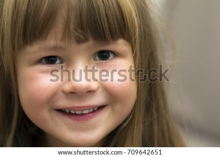 Close-up portrait of pretty little girl. Smiling child #709642651