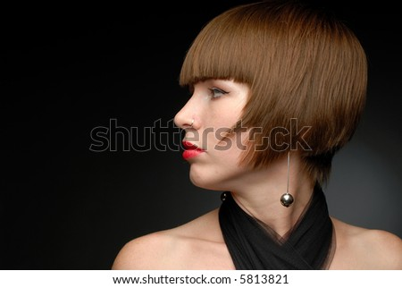 Close-up portrait of red haired girl turned sideways