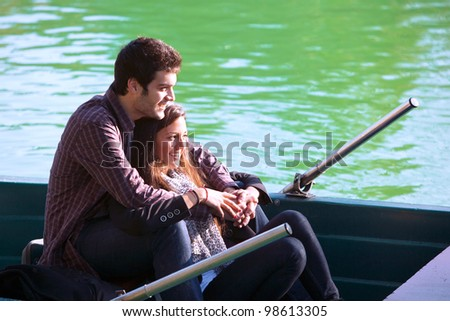 Close up portrait of romantic couple boating on river.