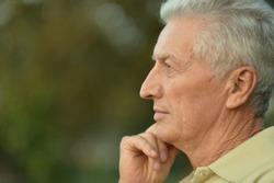 Close up portrait of sad senior man thinking