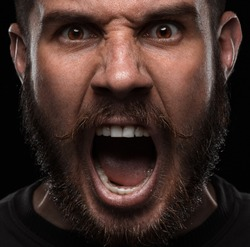 Close-up portrait of screaming and angry man