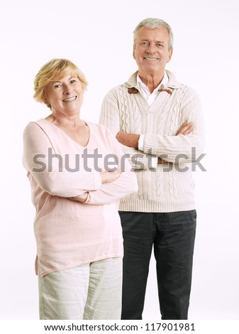 Close-up portrait of senior couple smiling against white background
