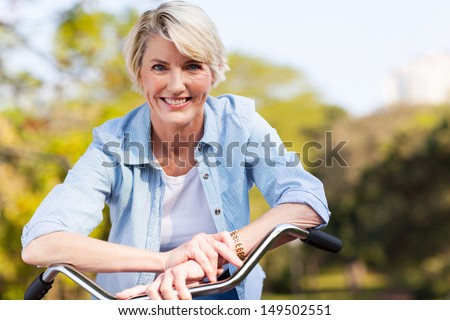 close up portrait of senior woman on a bicycle Stock foto ©
