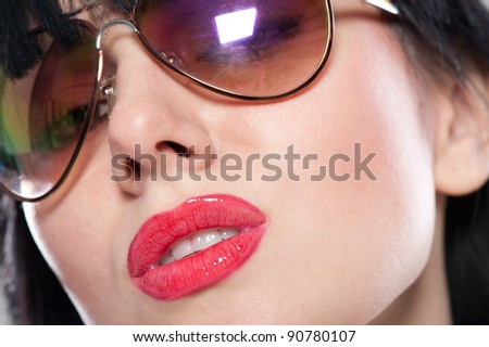 Close-up portrait of sensual and tender woman's face wearing sunglasses