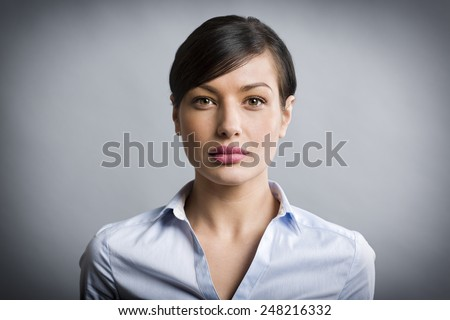 Shutterstock Close up portrait of serious, confident businesswoman looking straight, isolated on grey background.