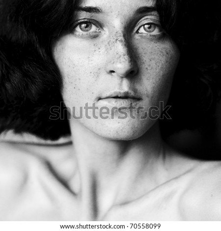 Close-up portrait of serious-looking woman - stock photo
