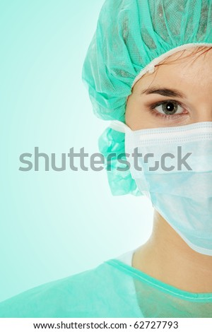 Close-up portrait of serious nurse or doctor in white mask