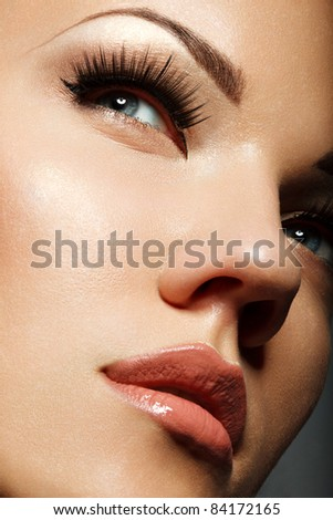 Close-up portrait of sexy caucasian young woman with long eyelashes
