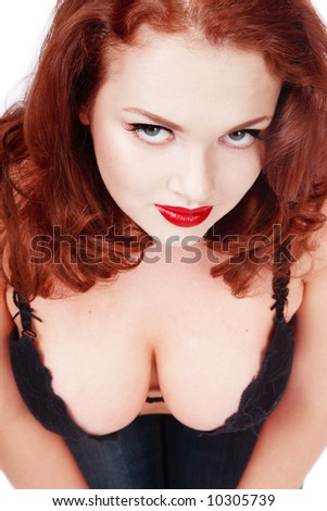 stock photo : Close-up portrait of sexy redhead in black bra showing her ...