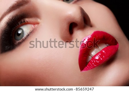 Close-up portrait of sexy young model with glamour red lips make-up