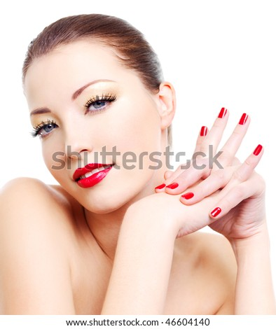 Close-up portrait of sexy young woman with golden glamour make-up and red gloss manicure - stock photo