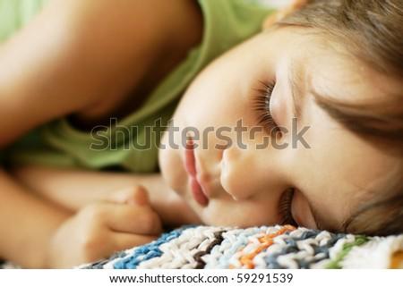 Close-up portrait of sleeping cute little boy