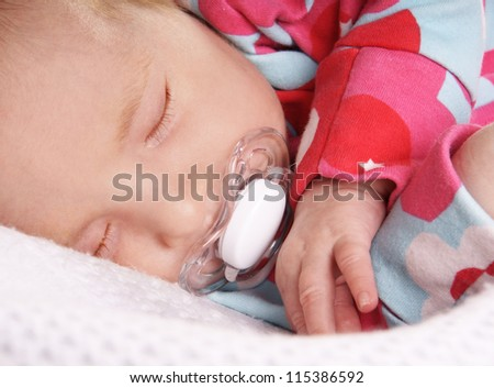 Close-up portrait of sleeping newborn baby, studio shot